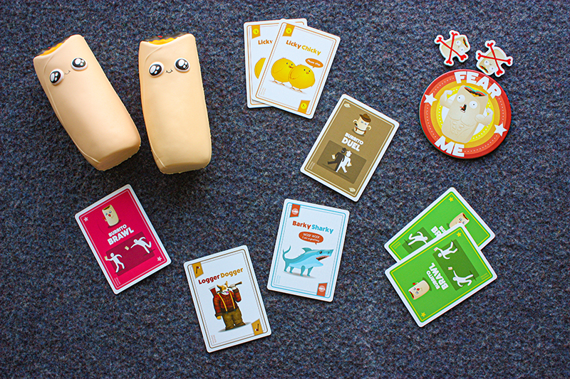 Throw Throw Burrito board game with the squishy burritos that you throw, the variety of cards and other pieces of the game.