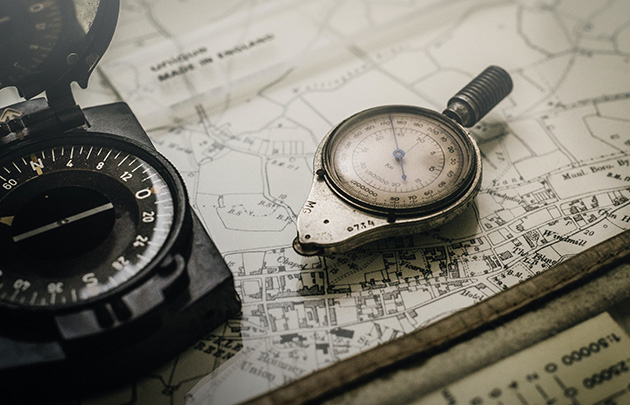 A compass and measuring tool on a topographic map